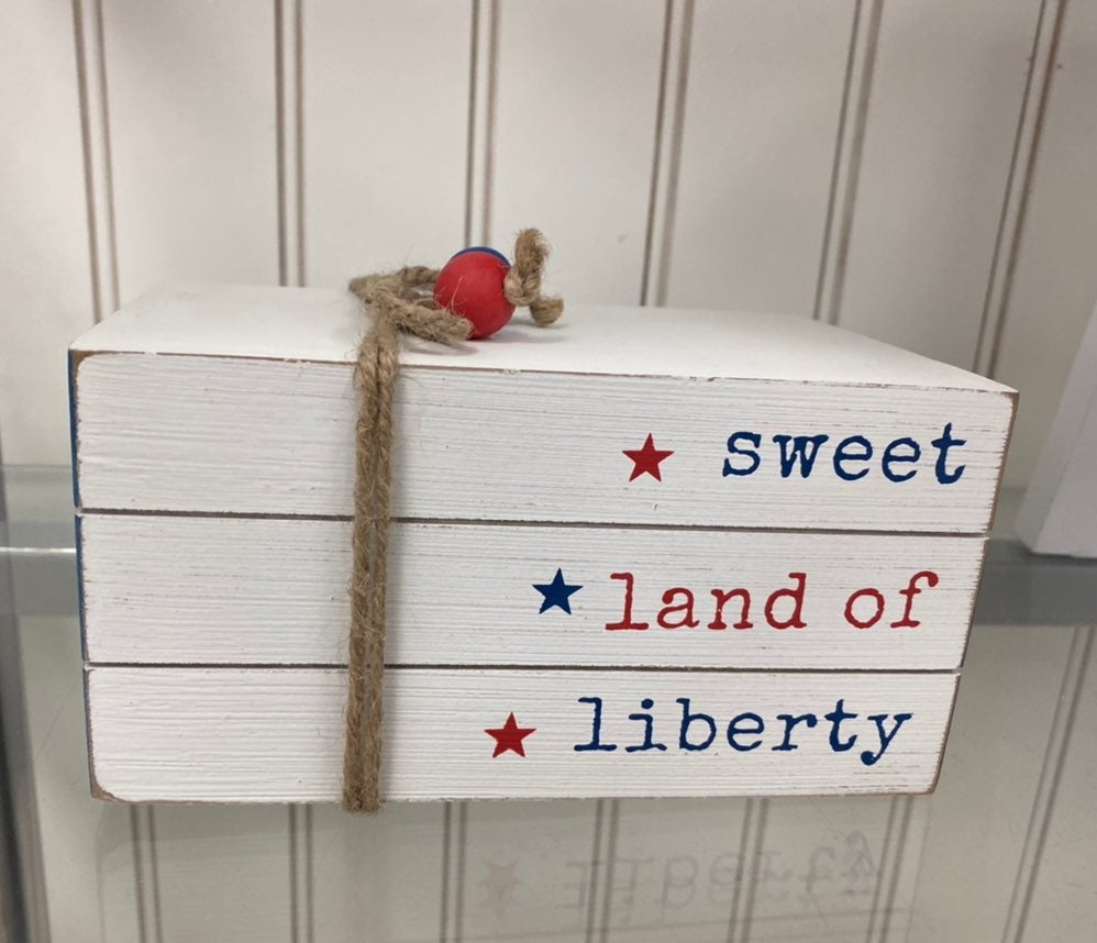 sweet land of liberty wooden book stack