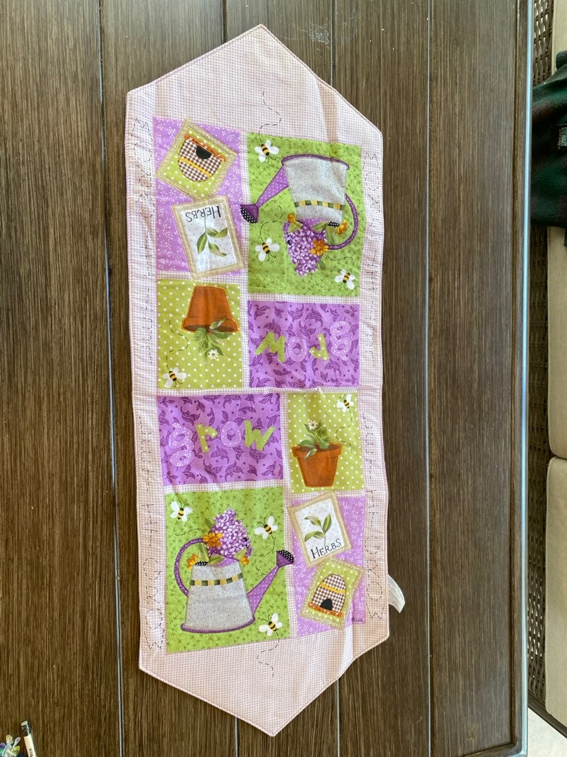 Quilted garden theme table runner