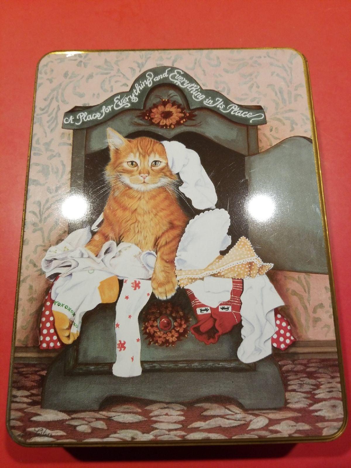 Cat tin with writing materials