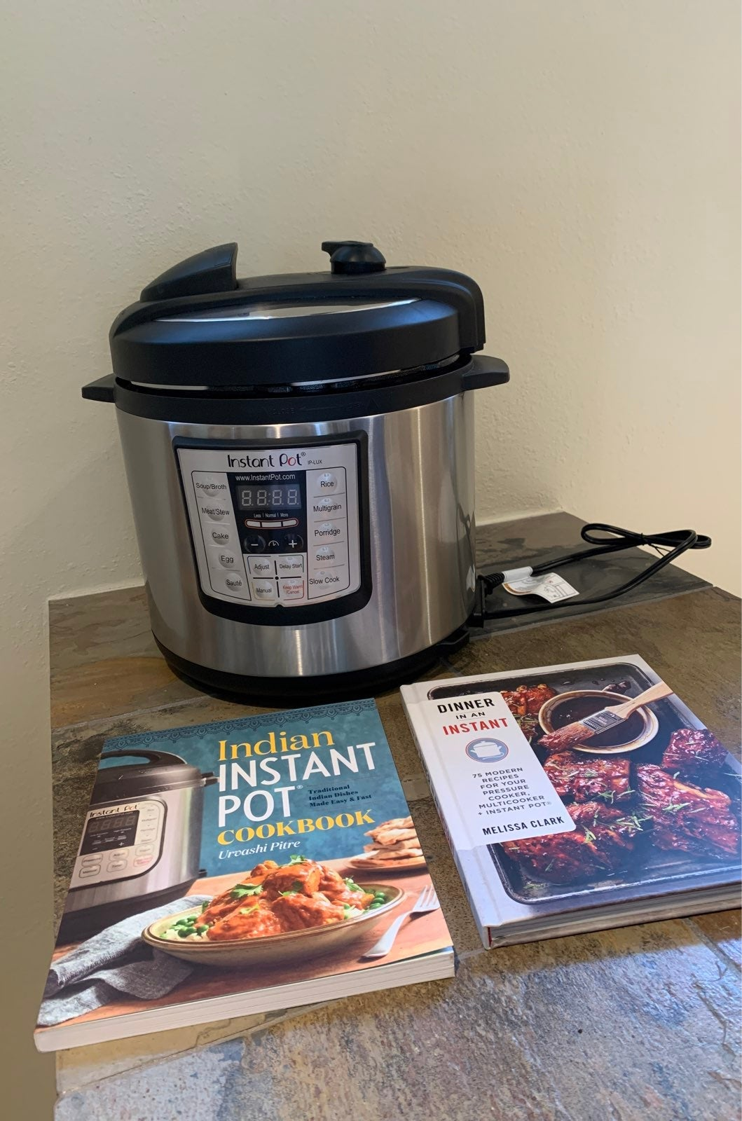 Instant Pot with cookbooks