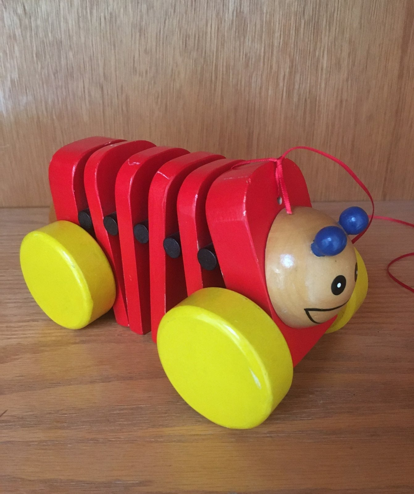 caterpillar pull-along toy, wooden (red)