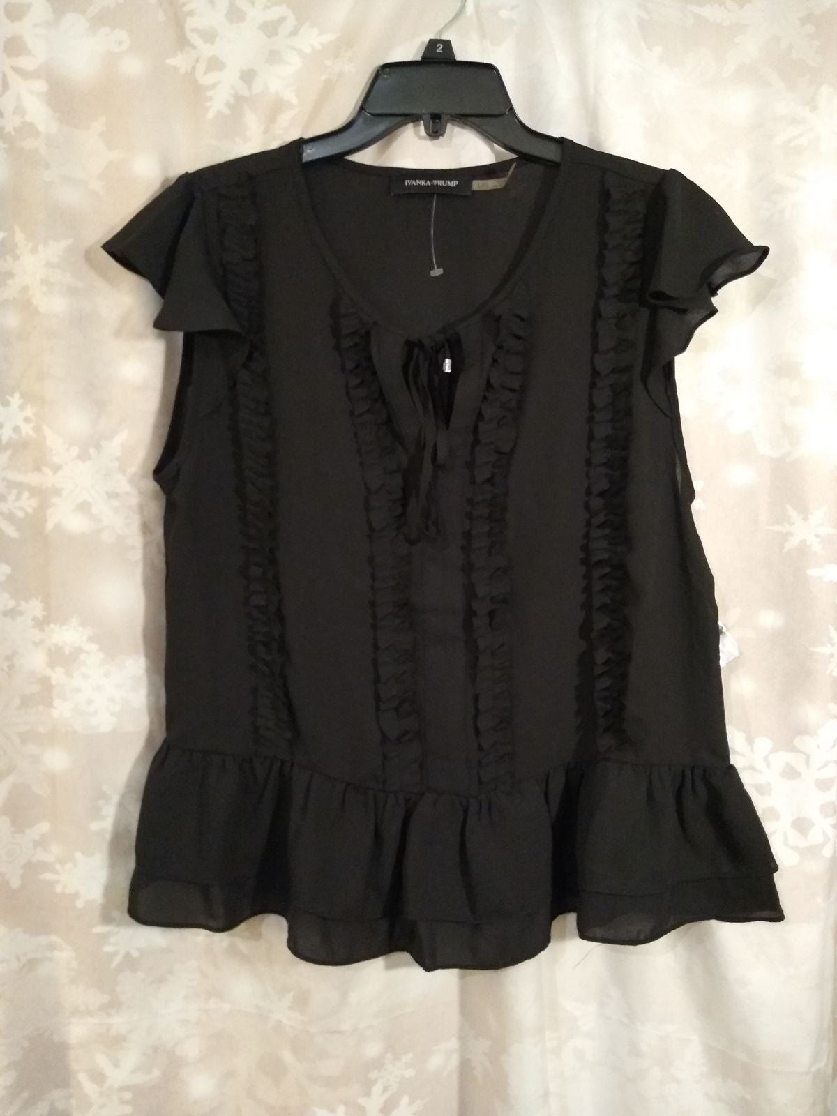 Black ruffled top