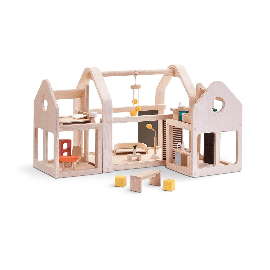 NEW* Plan Toys Slide N Go Dollhouse