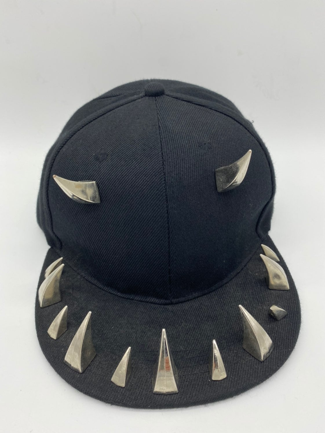Hat with metal design