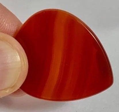#839 Red Orange Carnelian Guitar Pick