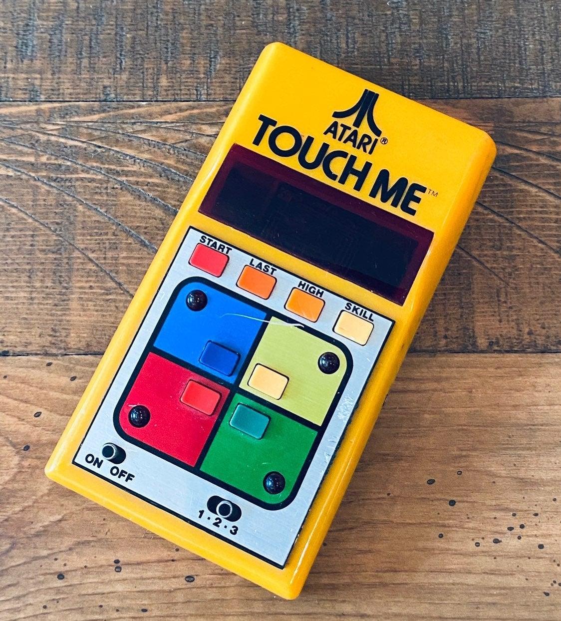 Atari Touch Me Game Electronic Handheld
