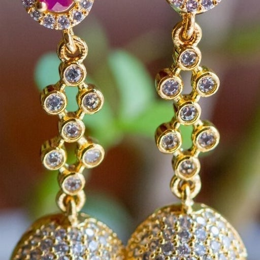 Long hanging earring with ruby and pearl