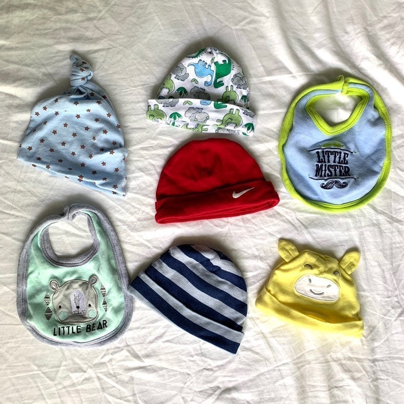 Assorted hats and bibs