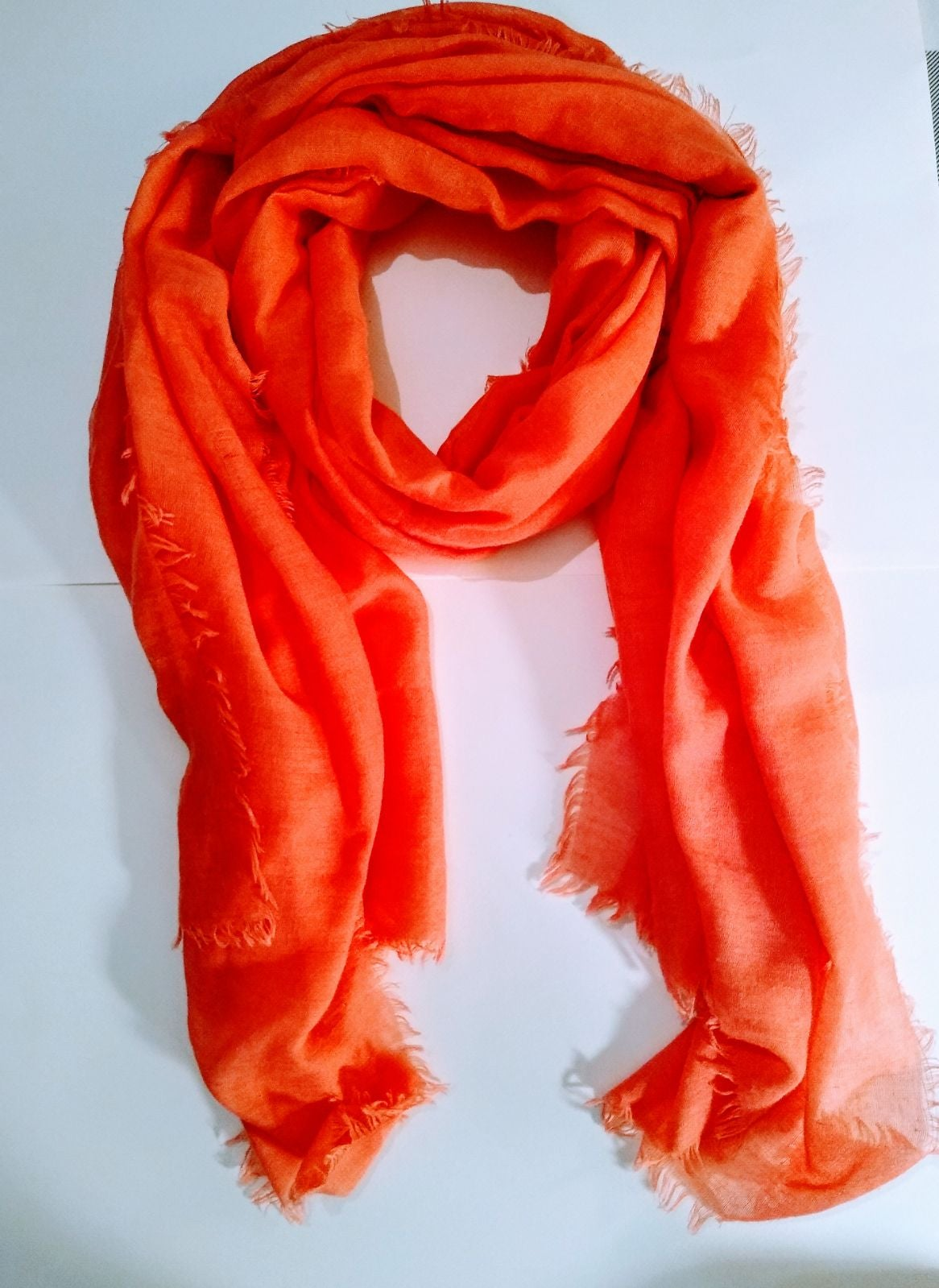 Ladies coral colored scarf