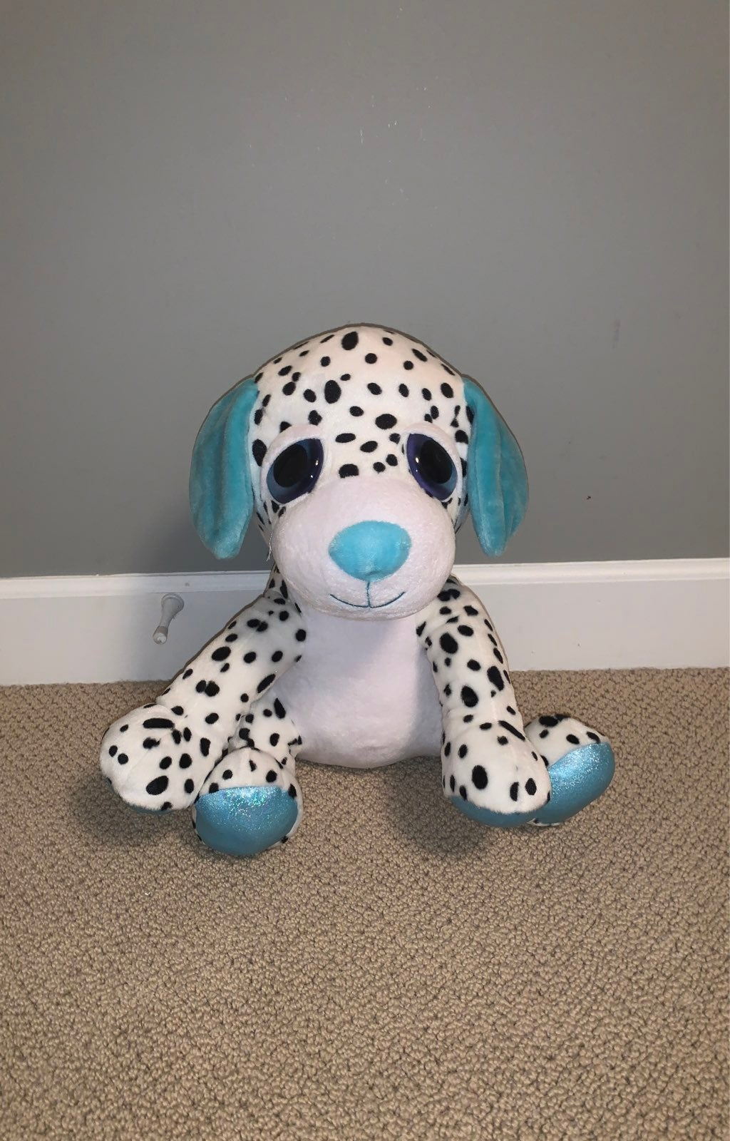 A bog white Polkadotted dog is in great