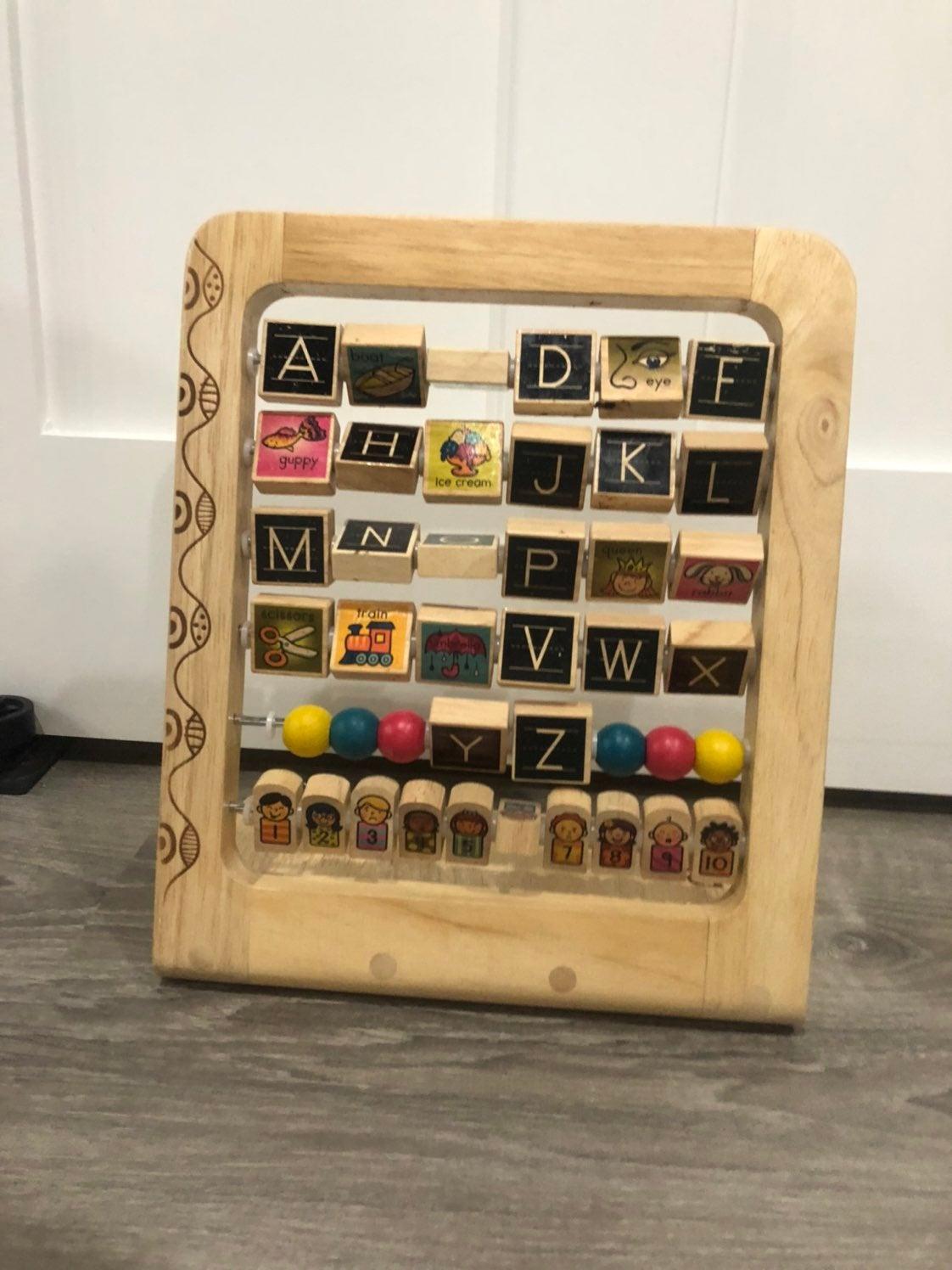 B. Wooden Alphabet toy