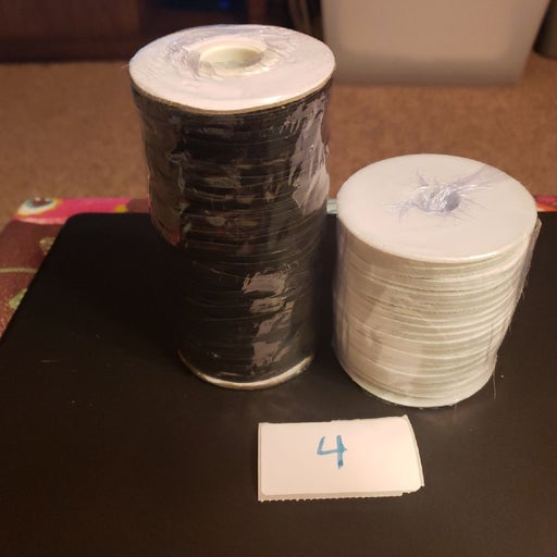 1 black - 1 white roll of Elastic