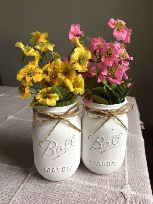 Distressed mason jars with silk flowers