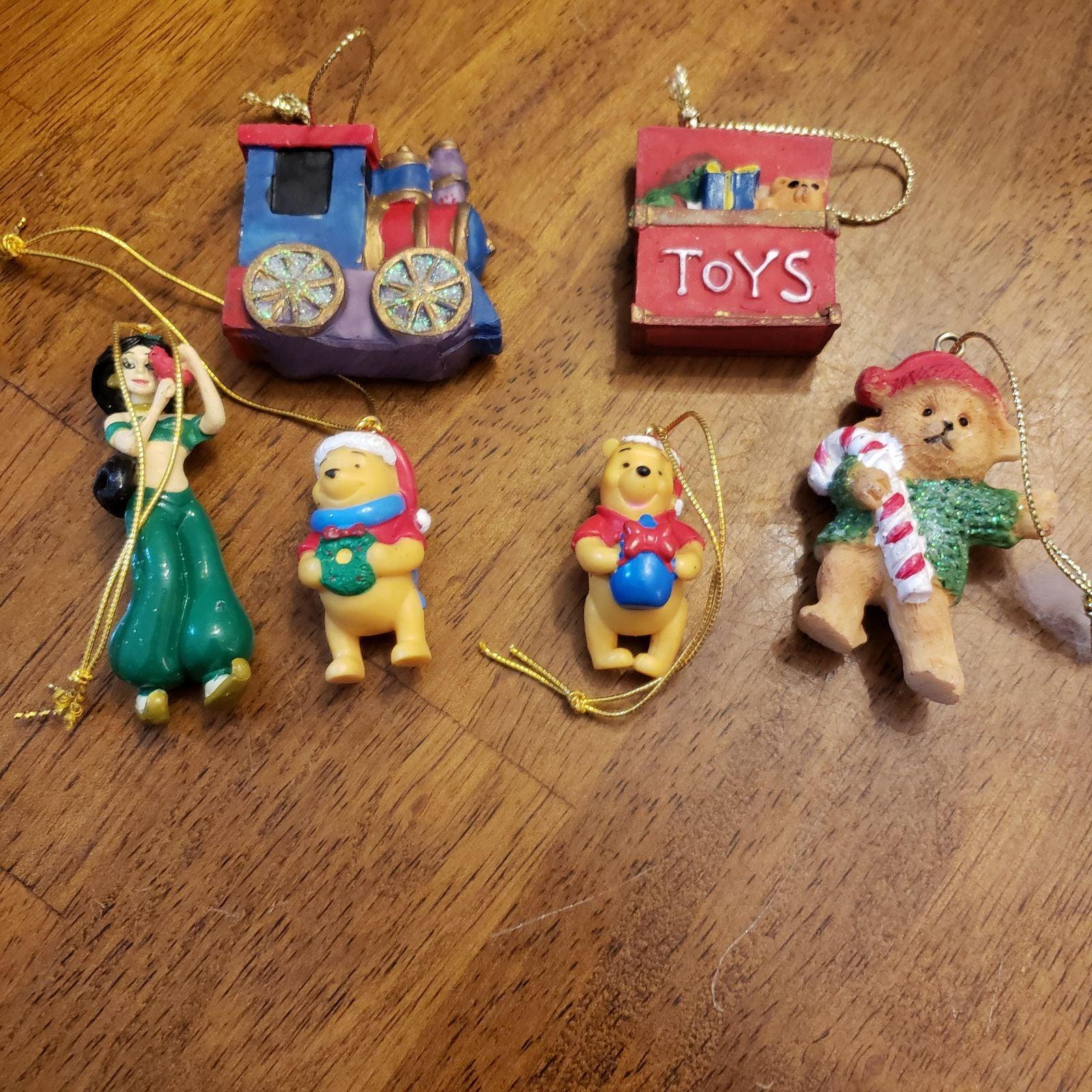 Disneys Winnie the Pooh and Jasmine mini