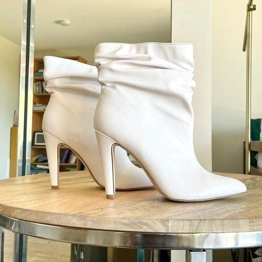 White heeled booties