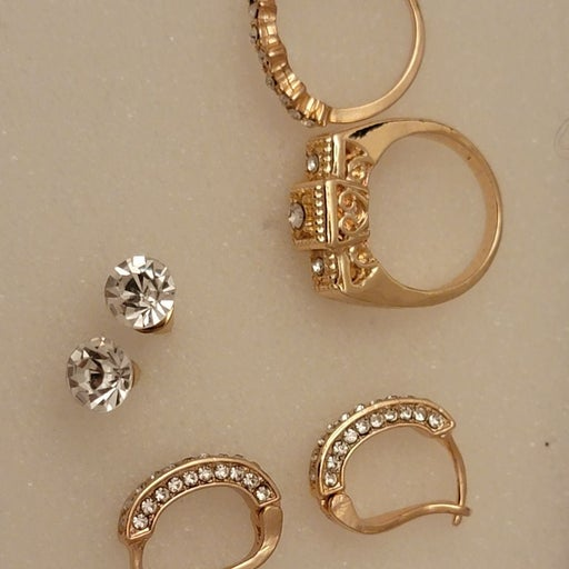 Gold over rings and earrings
