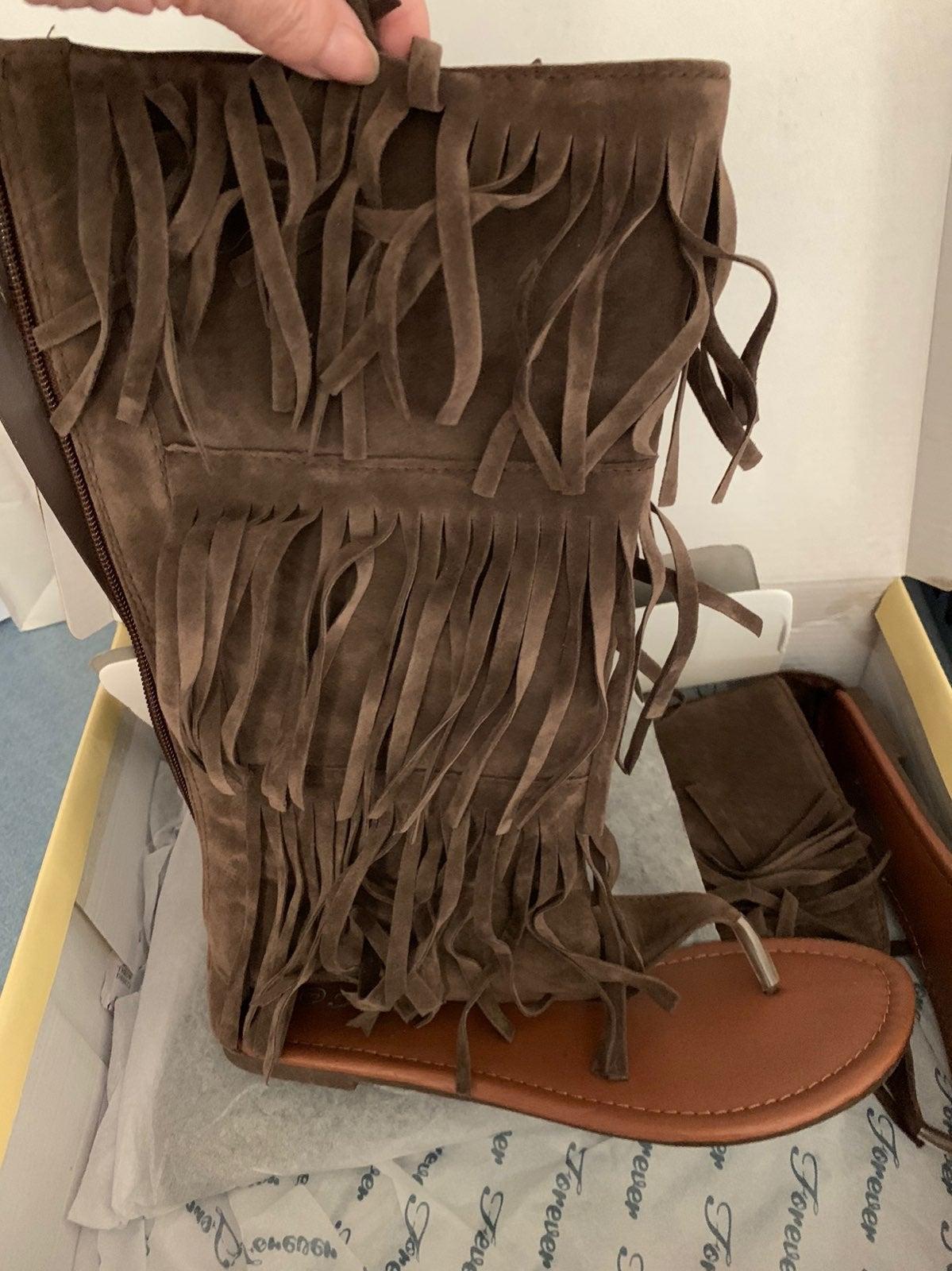 Calf high fringe sandal boot.