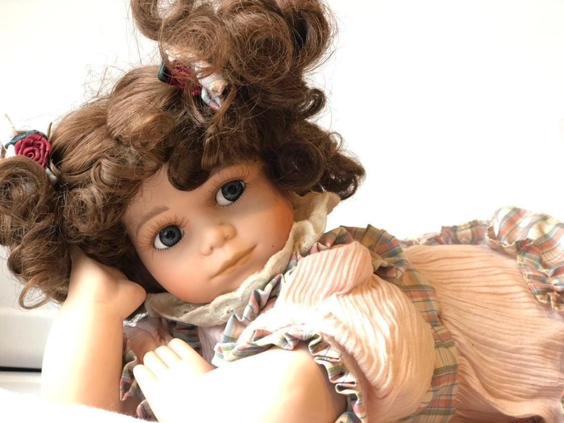 Vintage Brunette Porcelain Doll With Pil