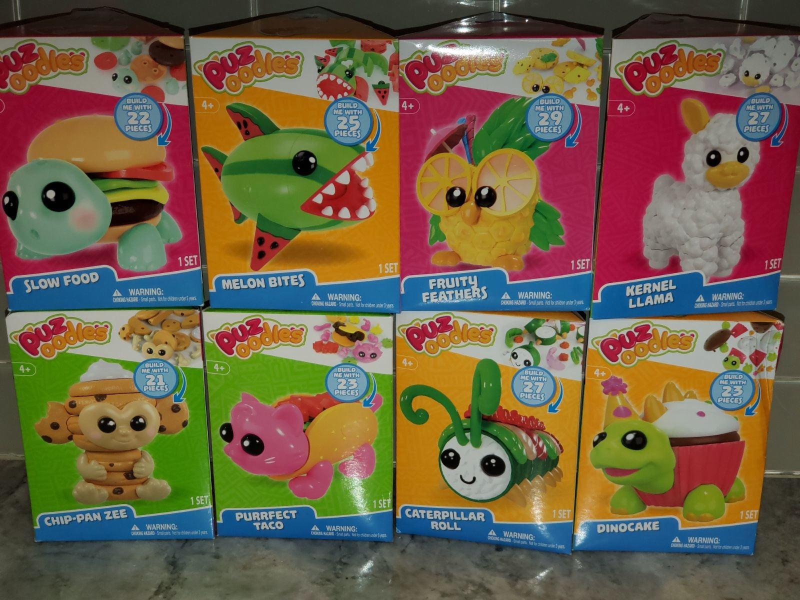 Puzoodles lot of 8 Toy Figure Puzzles