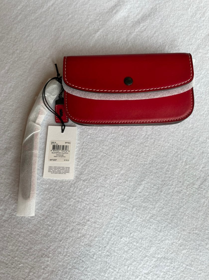 Coach 1941 clutch in the color 1941 Red