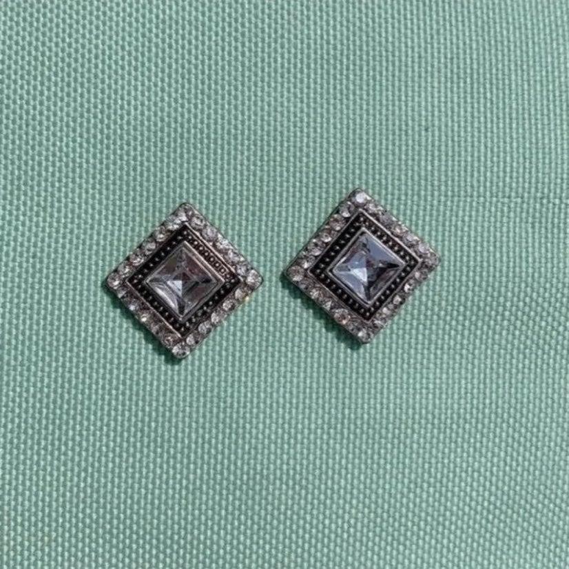 Buckle silver stud earrings