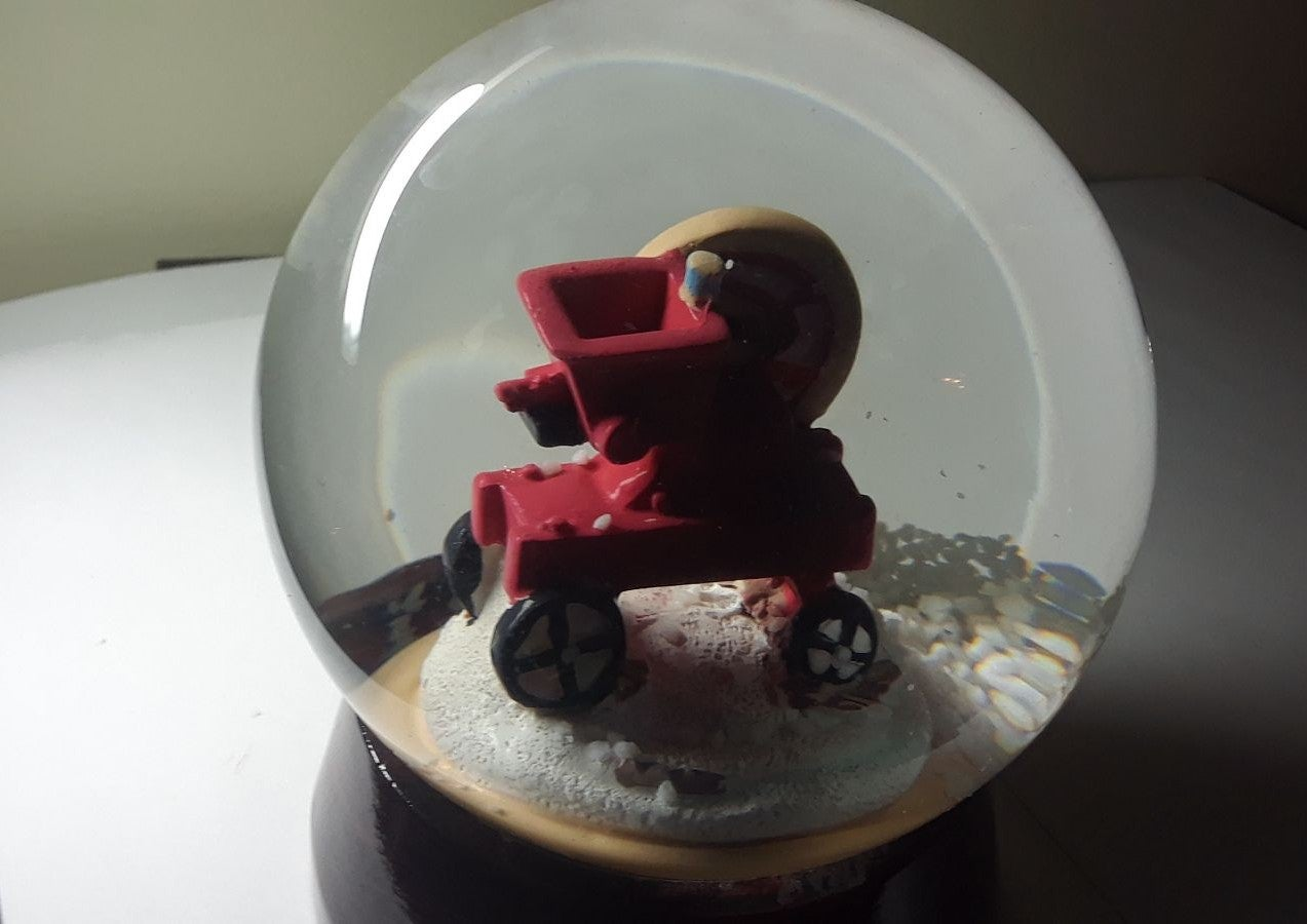 New Holland agriculture snow globe