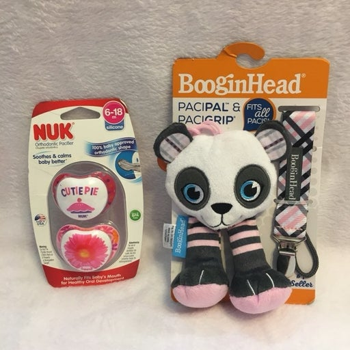 NWT pacifiers and clip