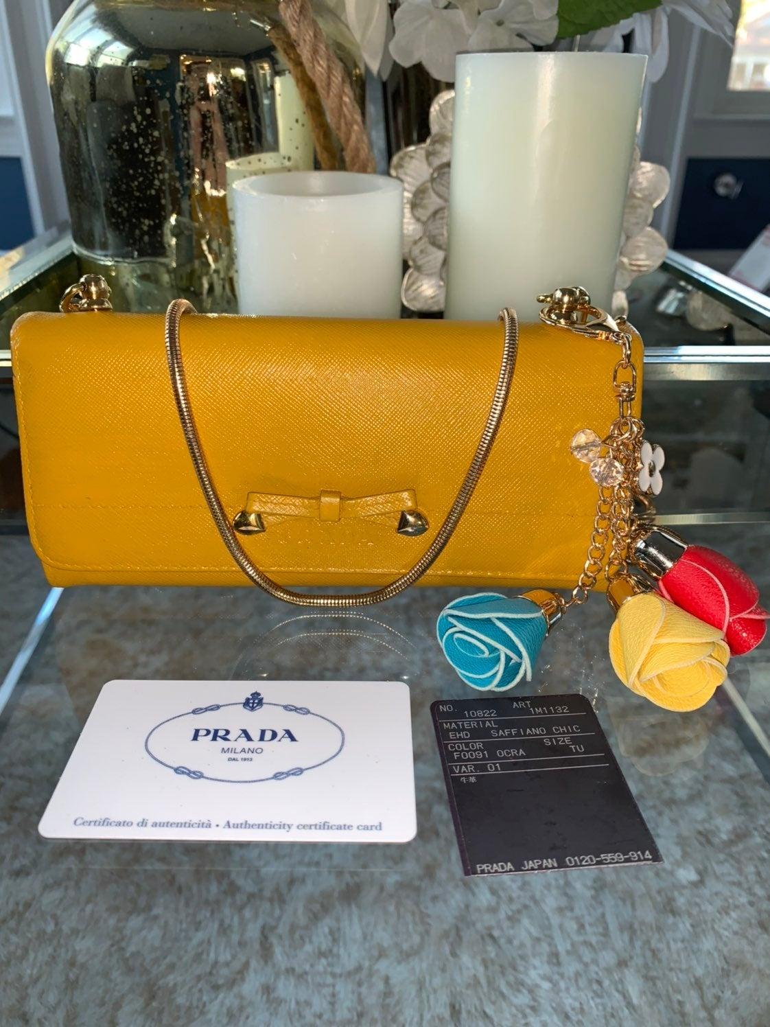 Prada mustard yellow crossbody wallet