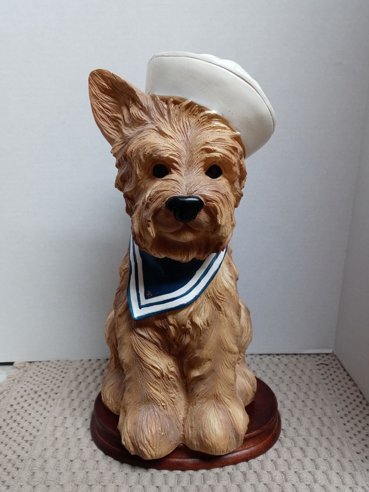 Polyresin sailor terrier statue.