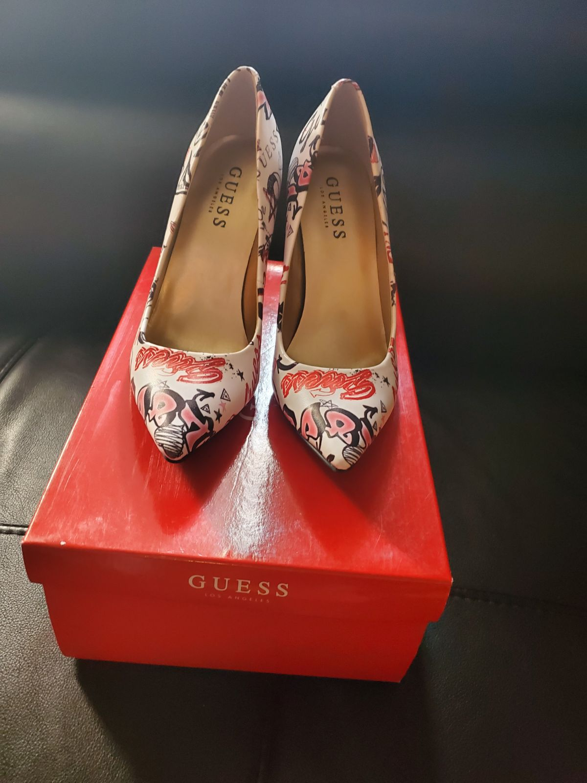Guess heels new in box never worn