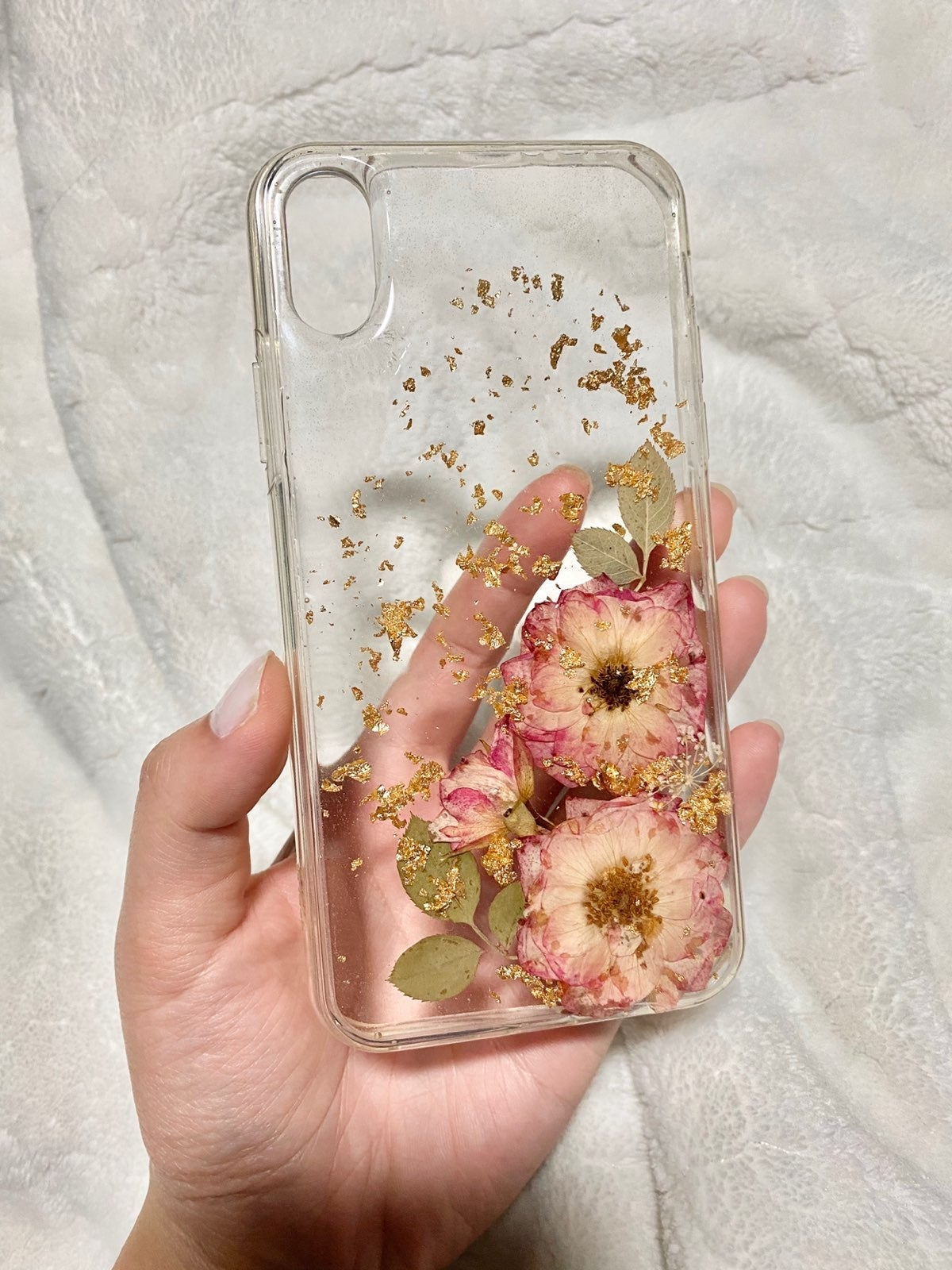 iPhone XS case with gold flake and press