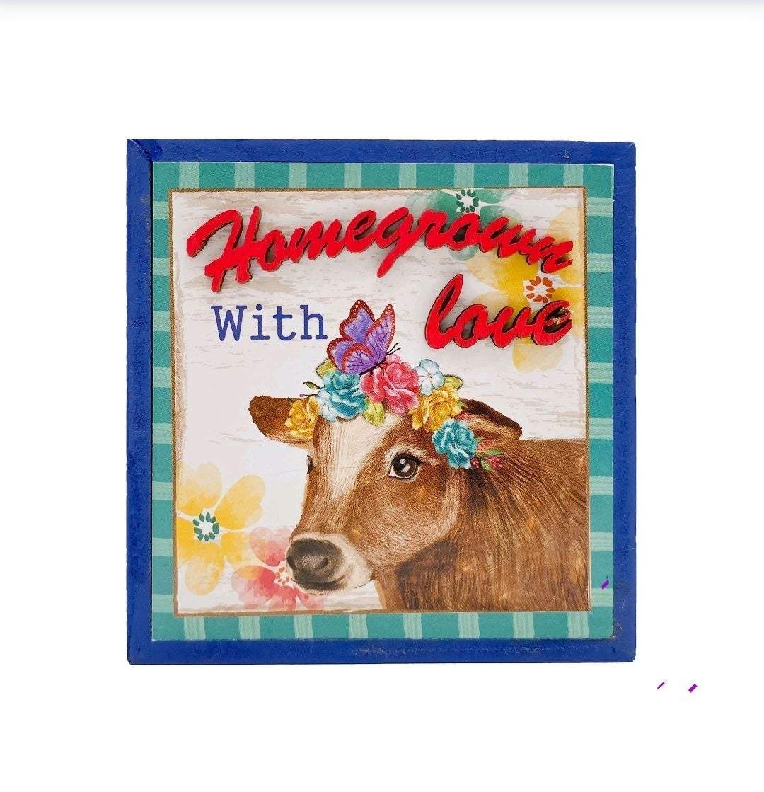 Spring cow box sign