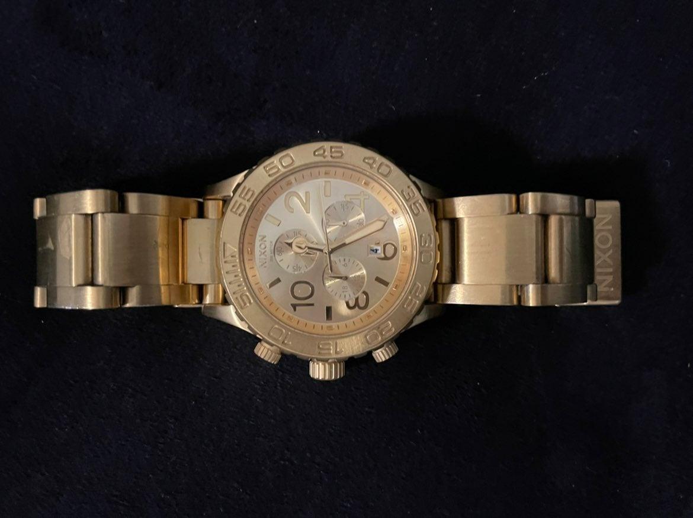 Nixion gold watch