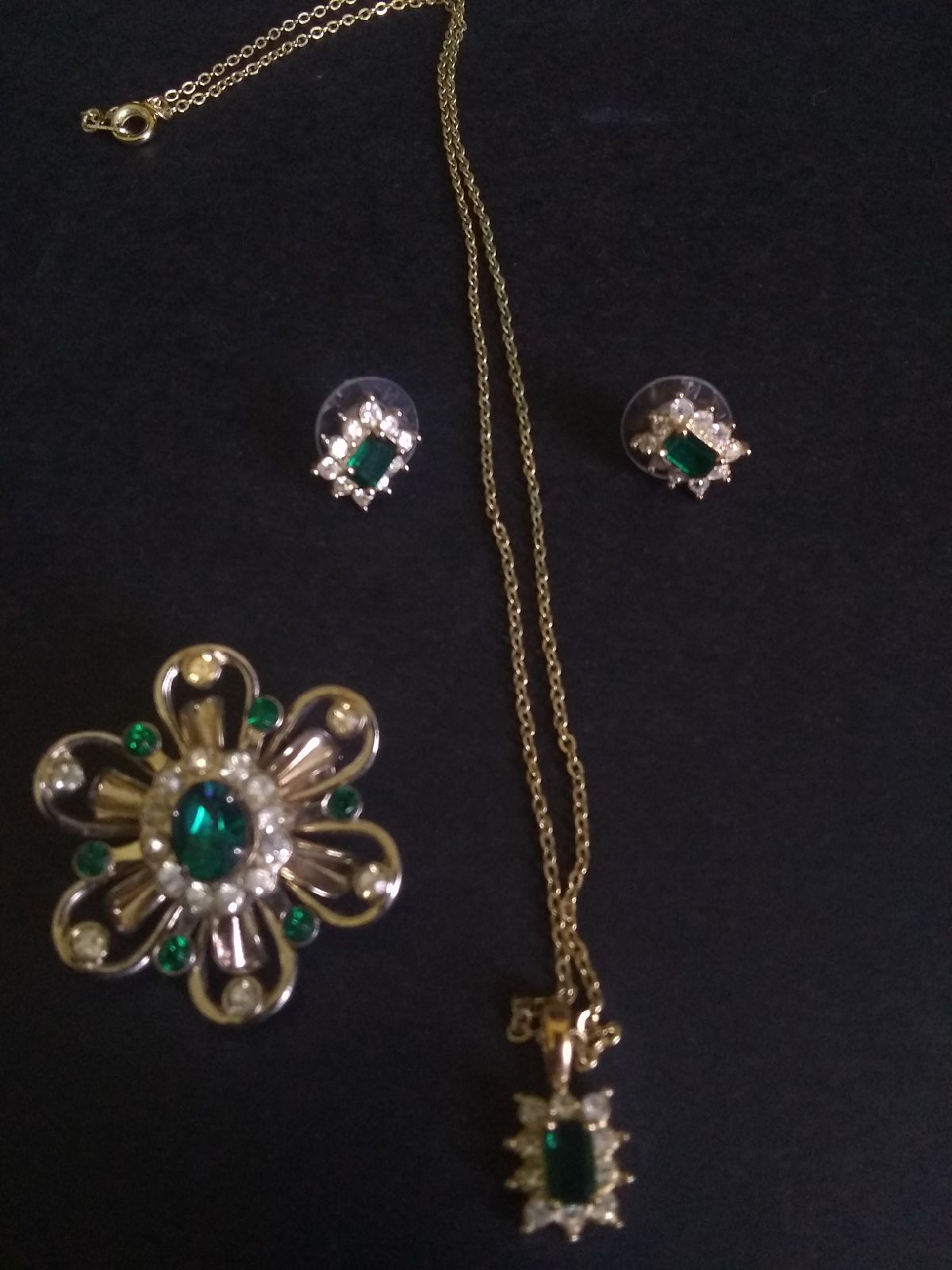 Necklace,earrings,and vintage Coro pin.