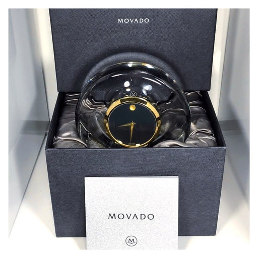 MOVADO SOLID CRYSTAL BLACK & GOLD CLOCK