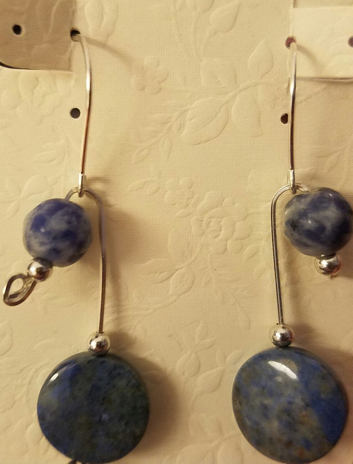 Silver wire wrapped earrings with blue s