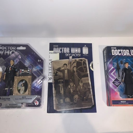 Lot of Doctor Who action figures and com