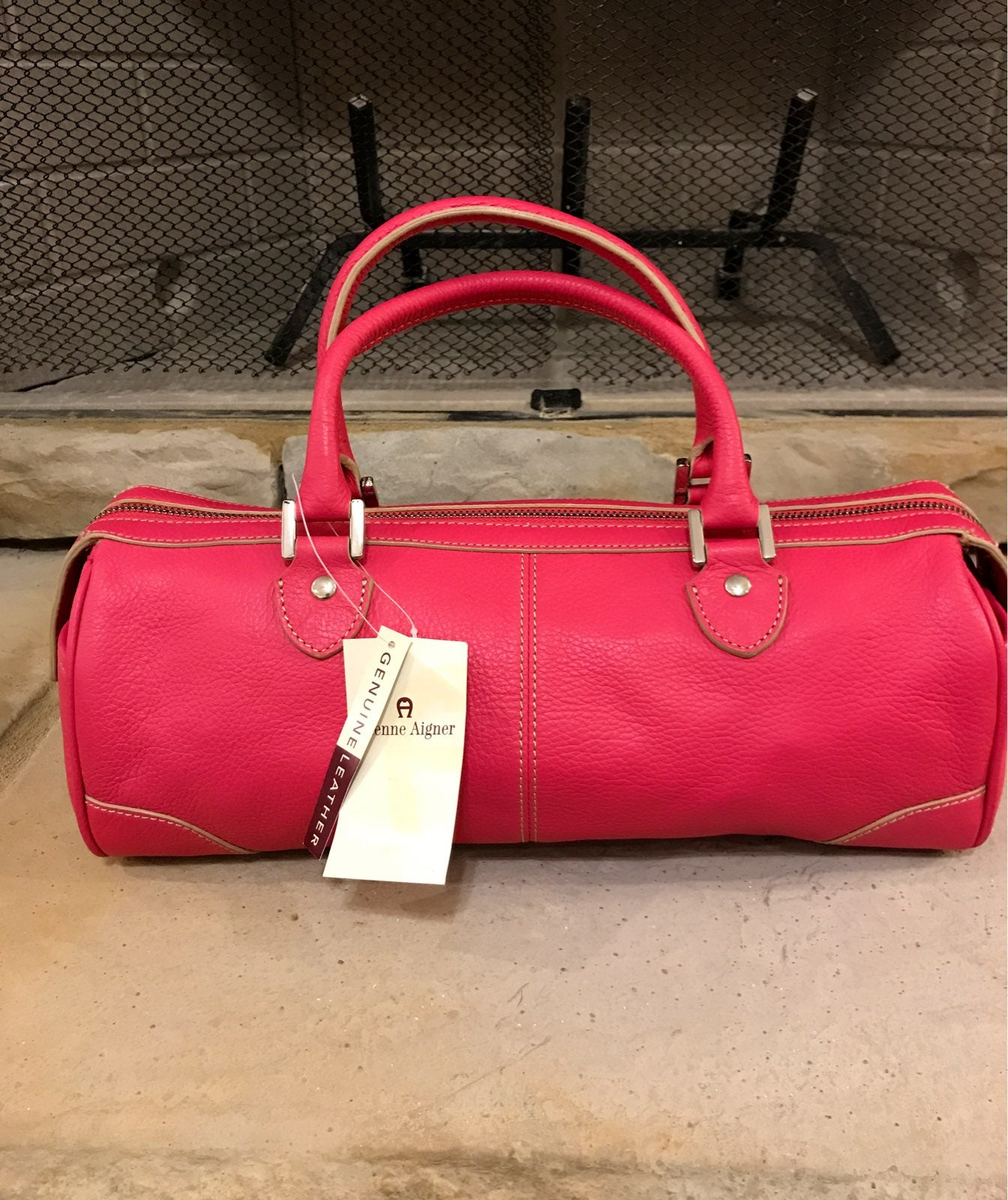 etienne aigner leather handbags and wall