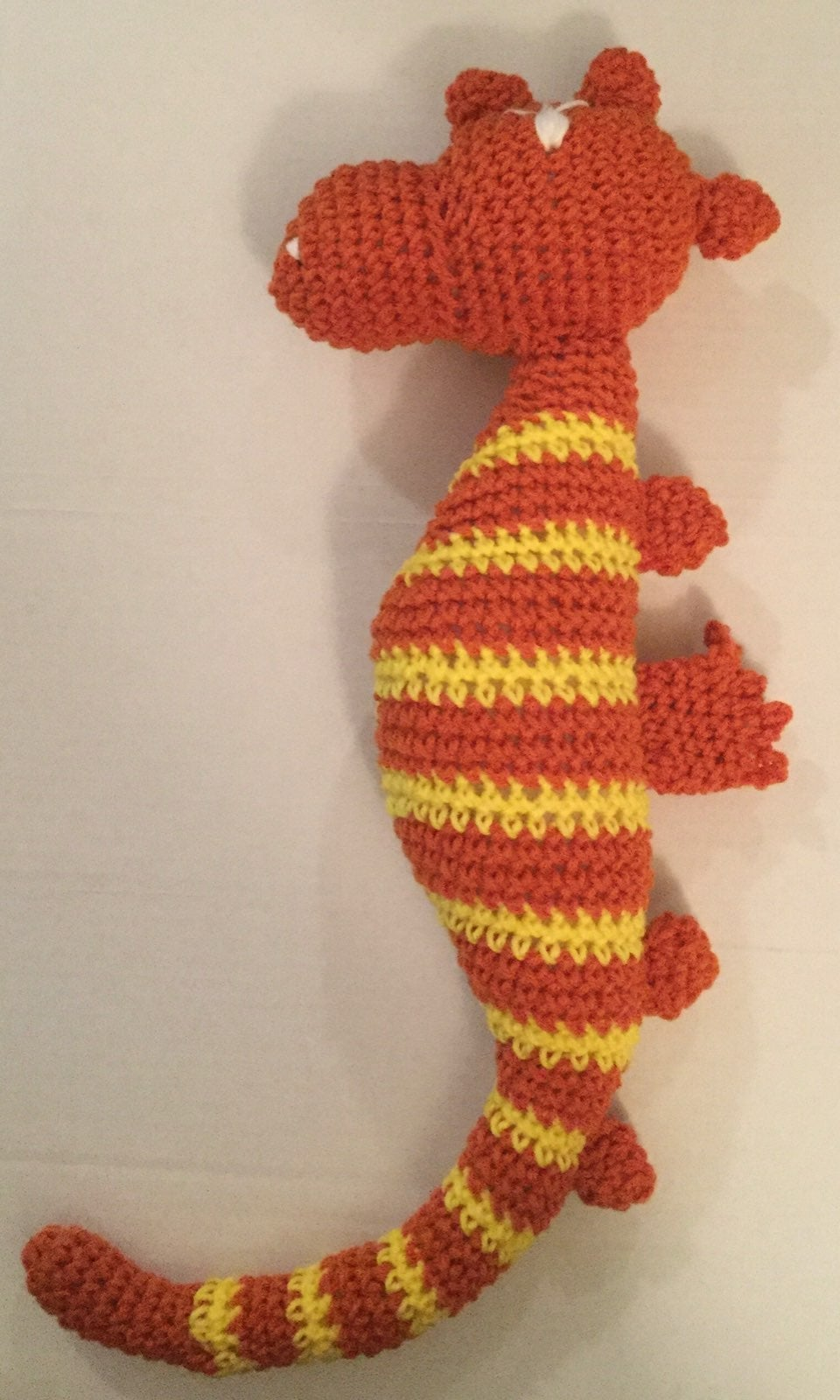 Crocheted sea horse, orange and yellow