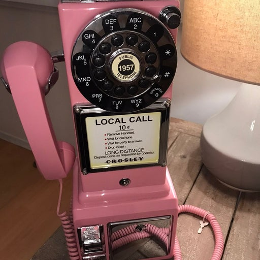Old fashioned Bubblegum pink pay phone.