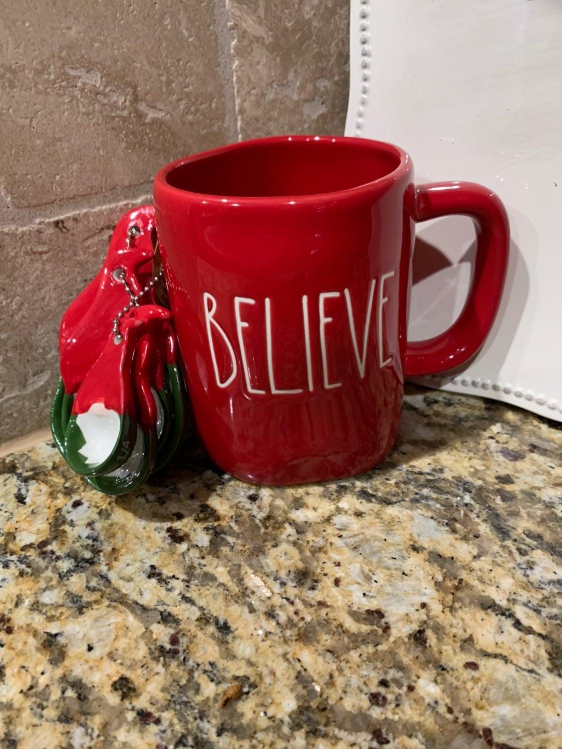 Rae Dunn Believe mug and gnome measuring