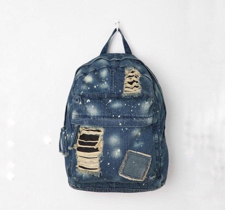 Distressed denim backpack