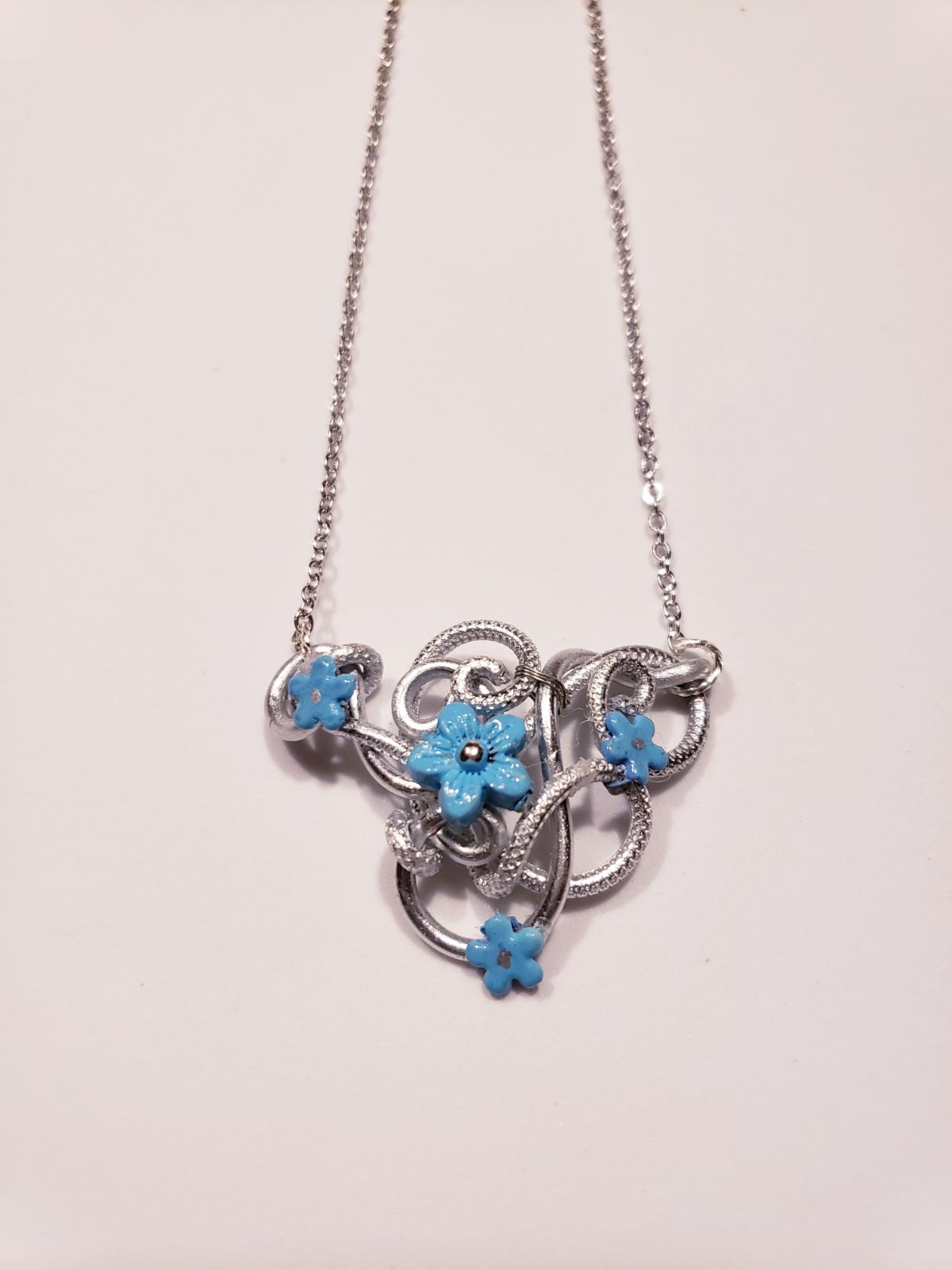 Wire Wrap Necklace with Blue Flower Acce
