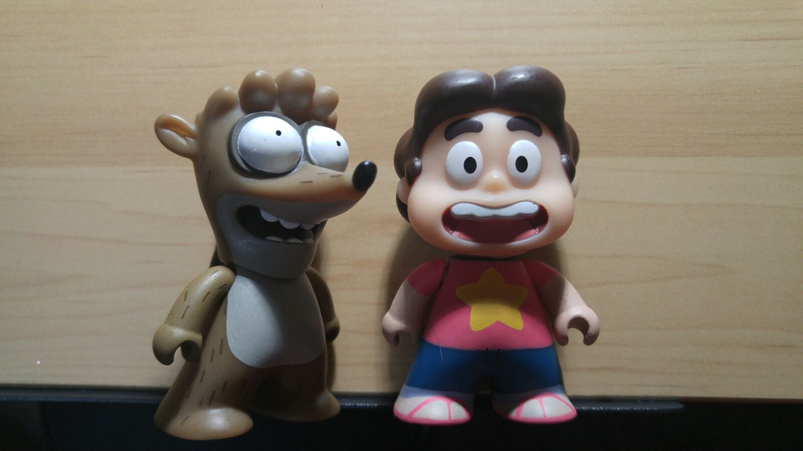 Steven Universe and Rigby Titans figures