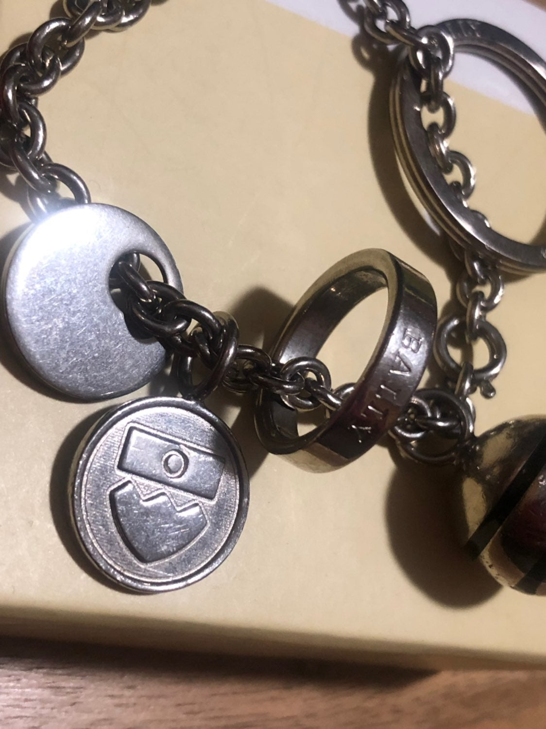 Bally Ring Keychain with four charms
