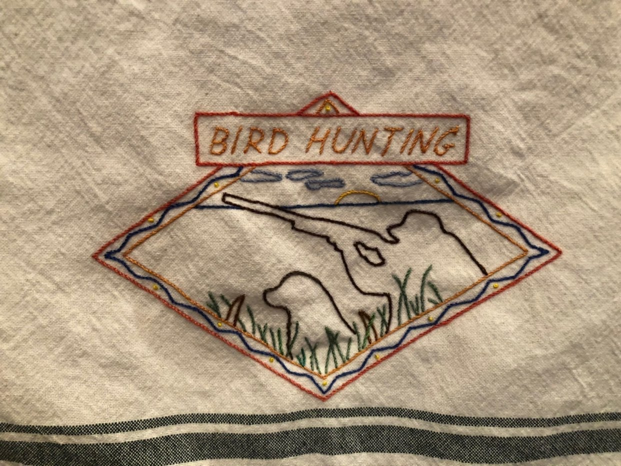 """Hand embroidered """"Bird Hunting"""" towel"""