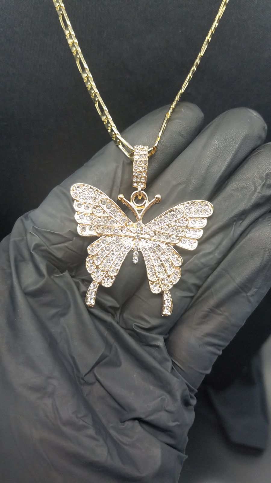 butterfly pendant on Figaro chain