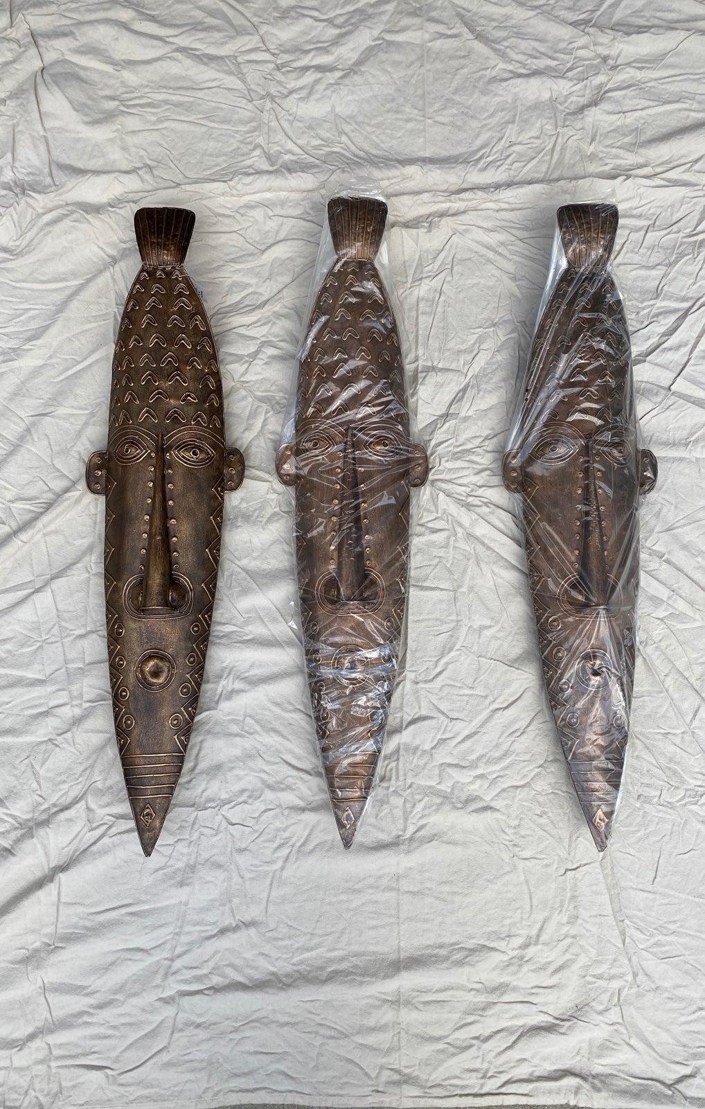Three handmade metal masks