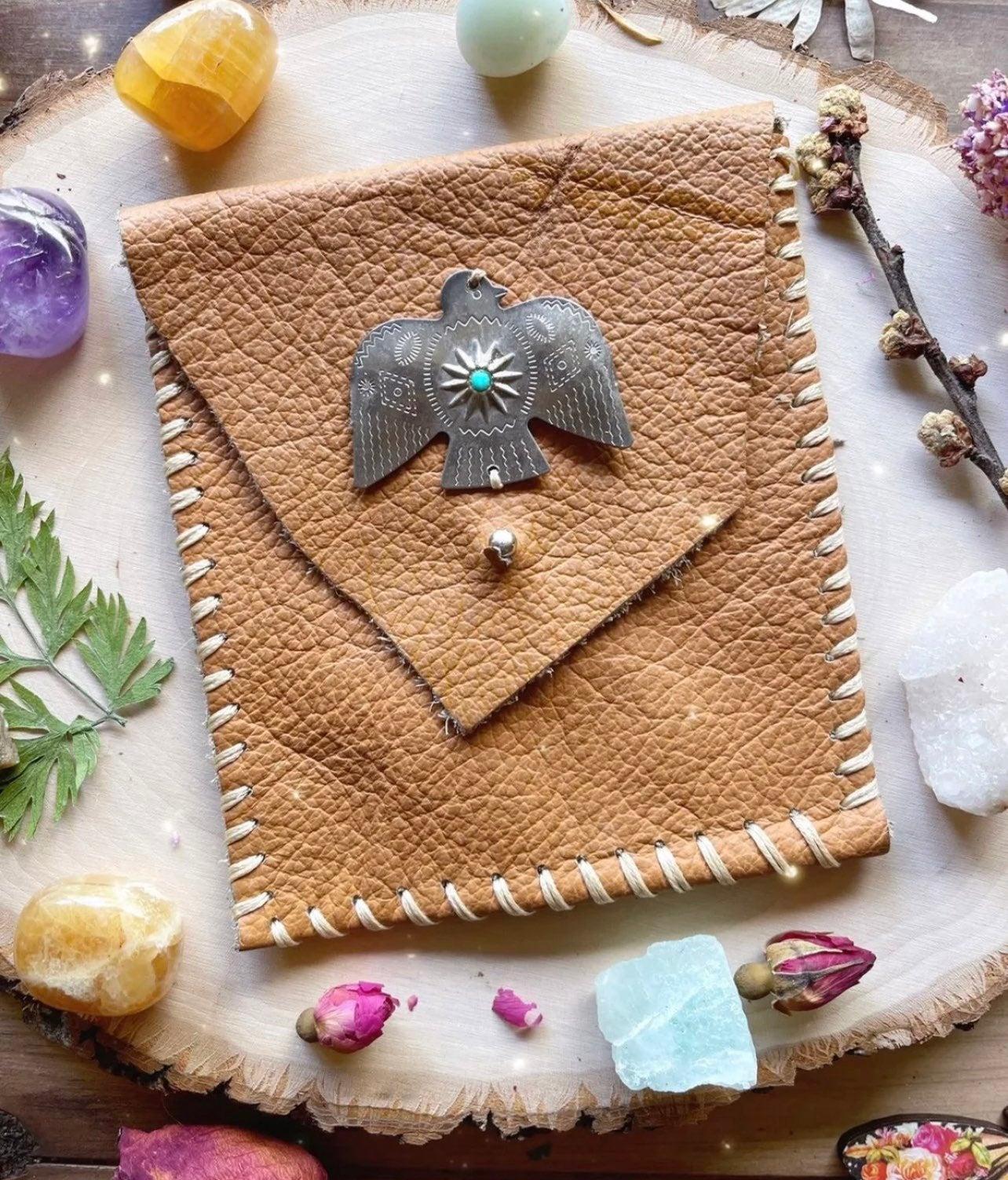 Leather thunderbird pouch