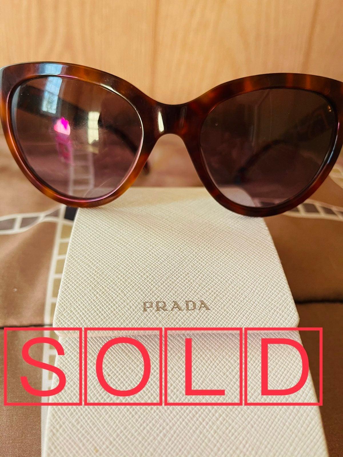 Prada cat-eye sunglasses.